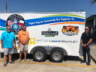 Bradley Law Proud to Help the Groves Police Officers non Profit Association by Donating a Trailer for Blue Santa Program.